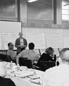 Scholars discuss research ideas at a Tobin Project conference